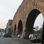 End of walls and back through Mussolini's modern arches