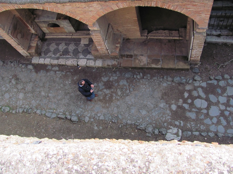 Looking down to street bar, Pompeii