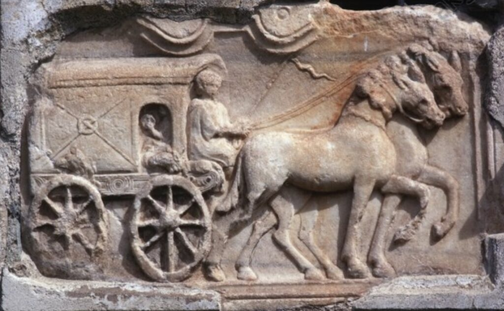 Roman relief depicting a travelling wagon (raeda)from a tomb from Virunum, Zollfeld, Austria.